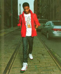 "Kid Cudi in Jordan Spiz'ike ""OG"" White/Varsity Red/Cement Grey-Classic Green"
